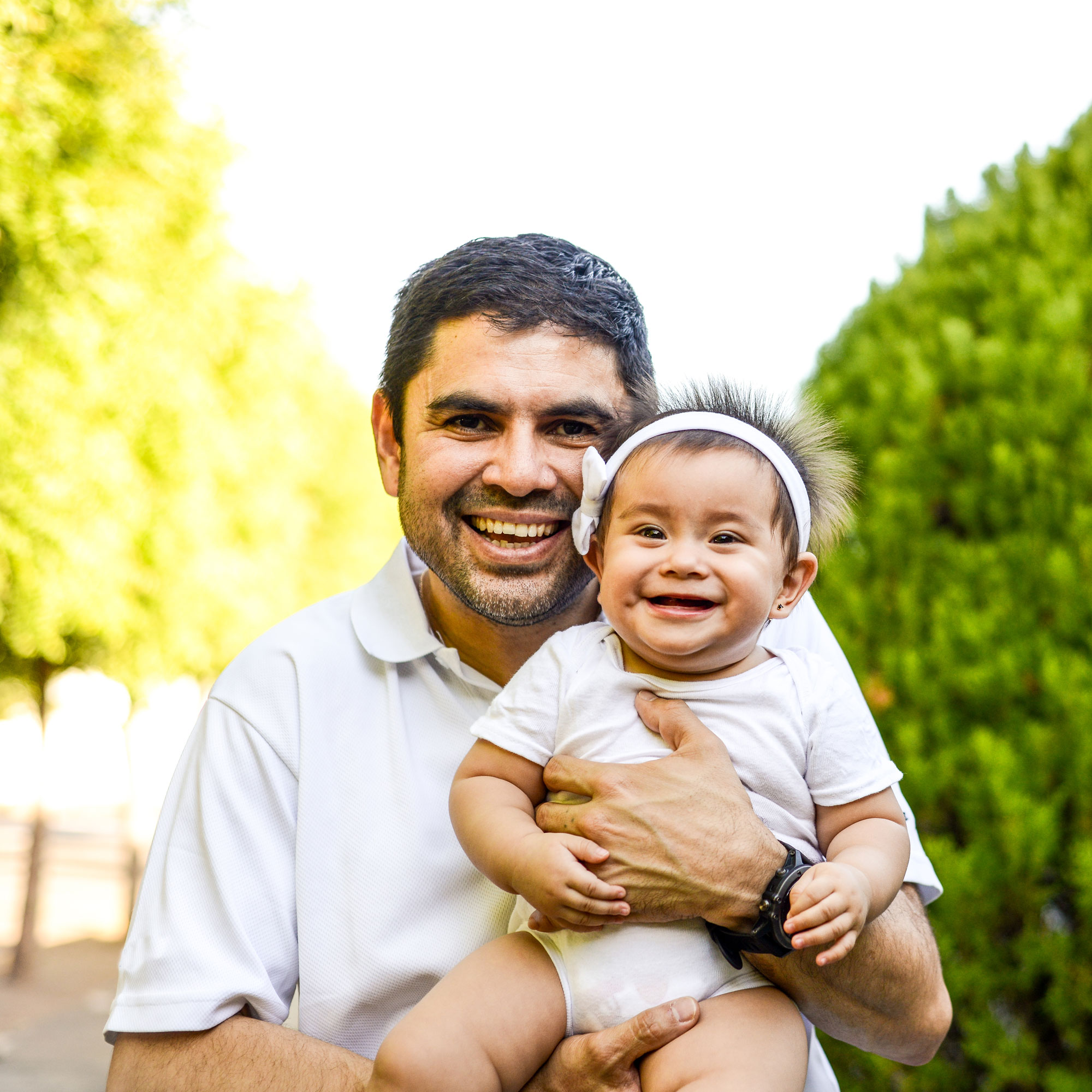 Smiling dad and baby