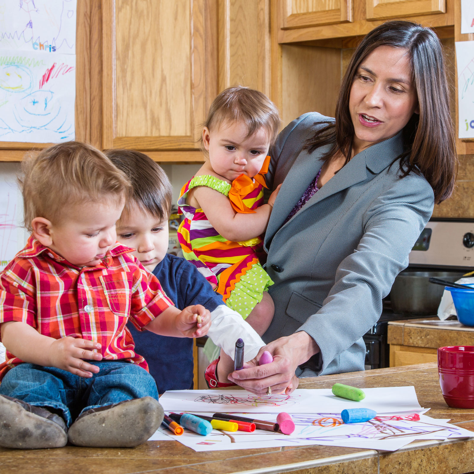 a busy working mom with her three young kids