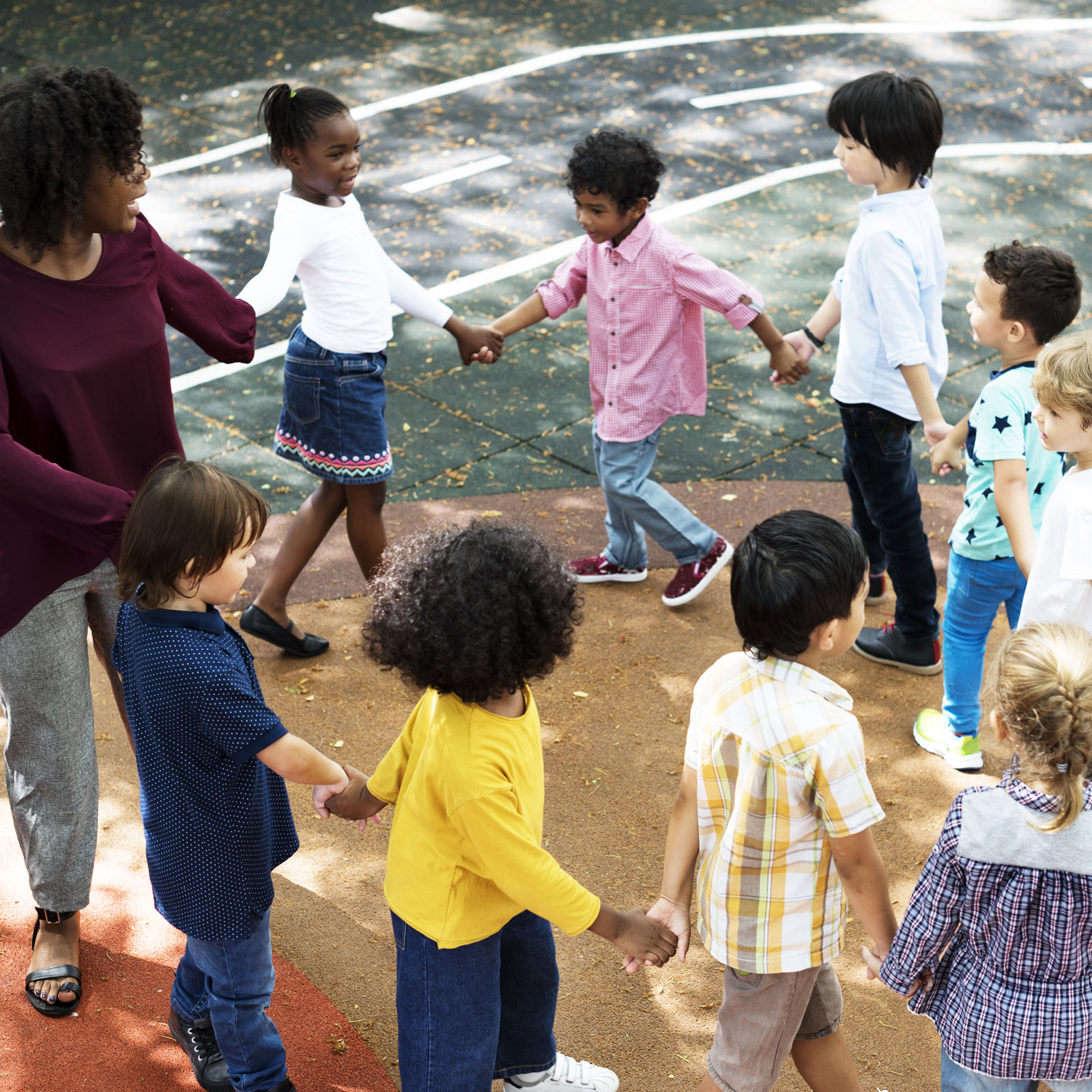 preschool kids holding hands and walking in a circle